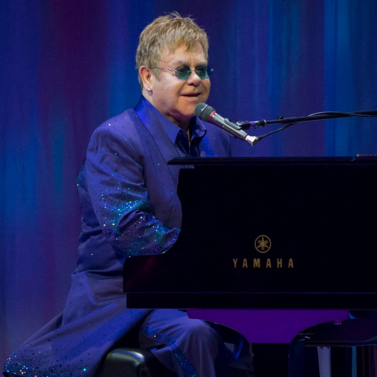Your Song! Princess Diana's close friend Elton John rocks the royal wedding receptions